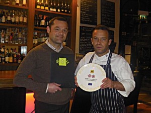Front of house manager Jonathan Bowker and head chef Jethro Lawrence with the new AA Rosette plate.