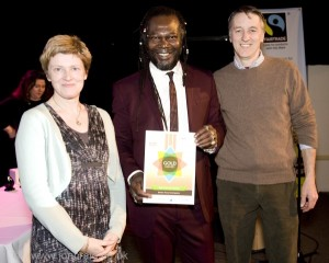 Phil Haughton (Better Food MD) Lucy Gatward (Better Food Marketing Manager) and Levi Roots, Colston Hall, March 13, Fairtrade South West Business Award (credit: Jon Craig)