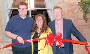 Left to right: George, Jenny and Marc conducting the ribbon cutting ceremony